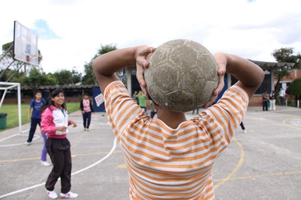 Taller kid throwing ball