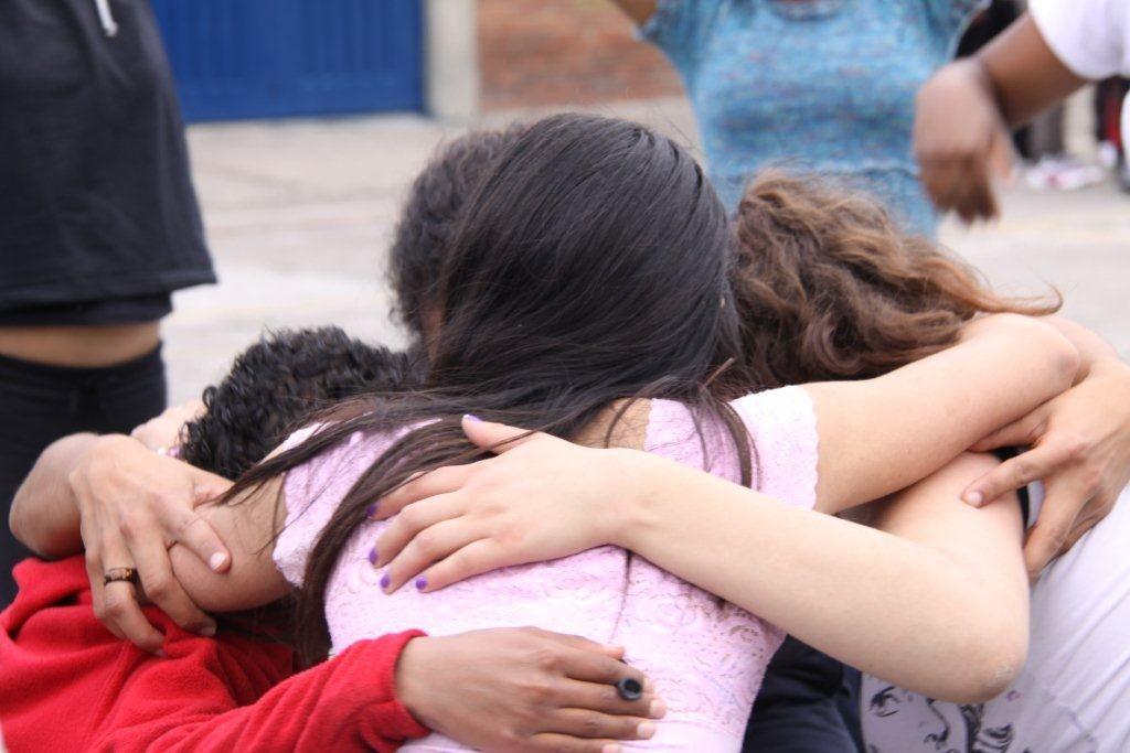 Taller kids hugging
